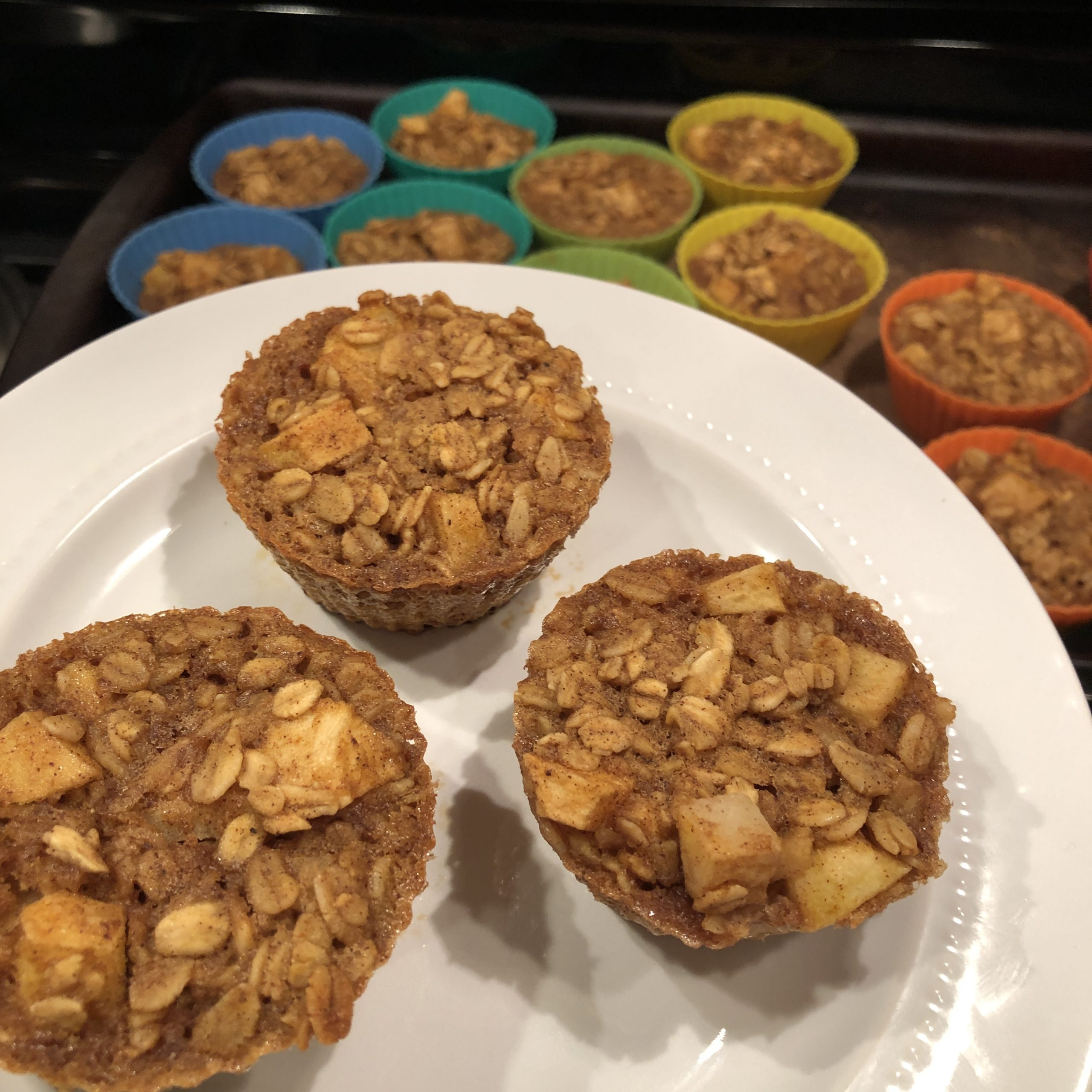 A plate with 3 Pumpkin Apple Baked Oatmeal Muffins