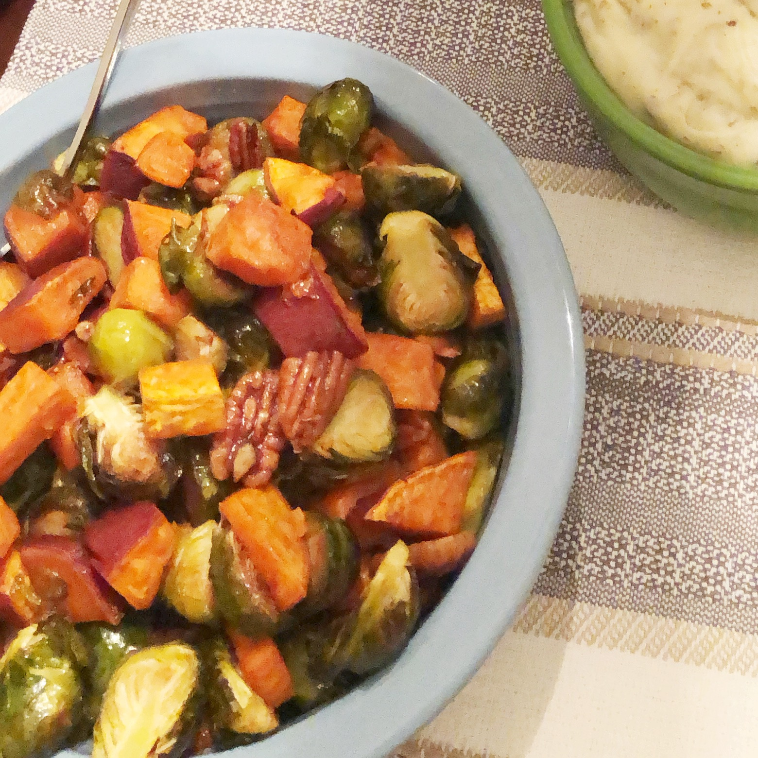 Bowl of Maple Roasted Sweet Potatoes and Brussels Sprouts with Pecans