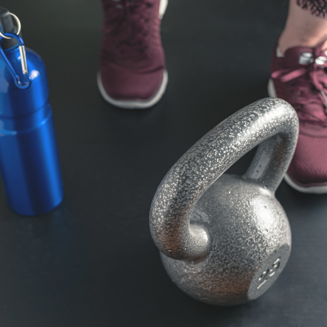 Image of tennis shoes, kettlebell, and waterbottle